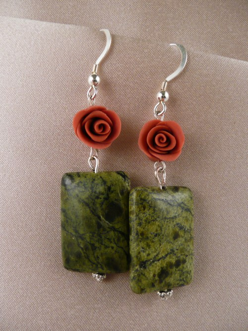 Red roses above serpentine jade rectangles
