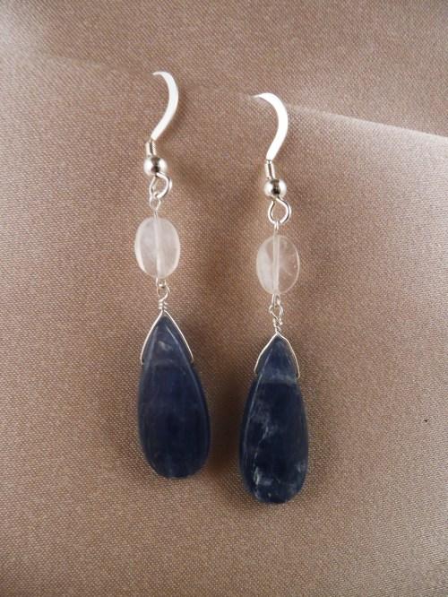 Teardrops of kyanite hang from oval moonstones